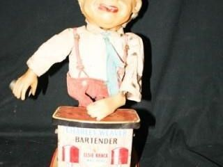 Charley Weaver Bartender  Tin Toy  Smokes