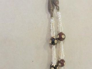 SEED PEARl NECKlACE ON GIlDED CORD WITH HAND