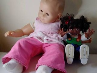 1 Battery Operated Doll and 1 large Pink Clothed Baby Doll
