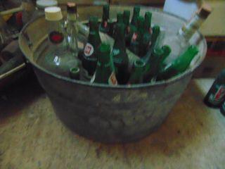 Galvanized wash tub with vintage Pop Bottles
