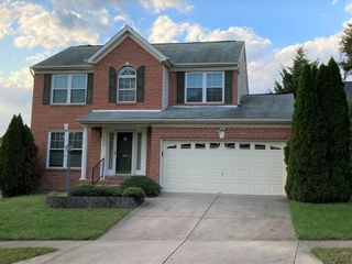 4 BR 3 1/2 BA COLONIAL STYLE HOME W/ ATTACHED TWO CAR GARAGE