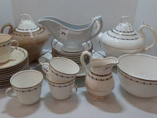 ASSORTMENT OF DISHES   TEAPOT  CUPS AND SAUCERS