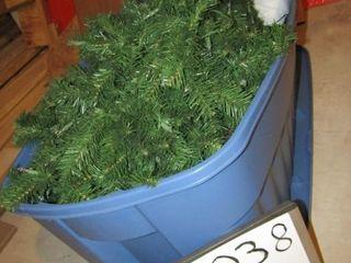 Green Chirstmas tree in bin