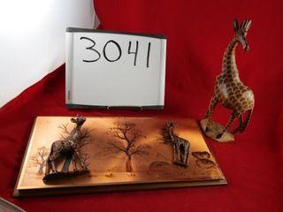 Copper giraffe  and wooden giraffe
