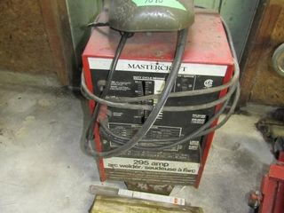 Mastercraft 295 amp welder with helmet and rods