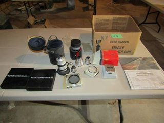 assorted camera lenses and filters