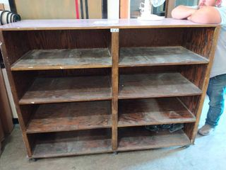 large wooden cabinet on Wheels 73 l x 26 D x 54 T