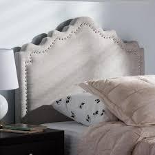 Nadeen Modern and Contemporary Fabric Headboard   King   Buff Beige   Baxton Studio