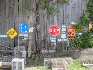 lARGE QUANTITY OF ROAD SIGNS  HAY FORKS  SCRAP ETC