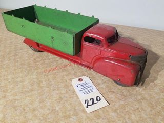 Vintage red truck with green box