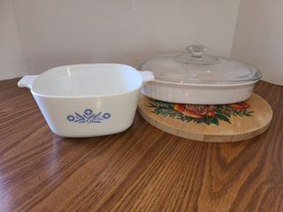 3 pcs  Corning Ware and a Wooden Trivet