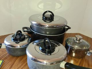 9 Pcs  Pots and Pans with 4 lids  7 pcs  are T FAl Pots and the other is Stainless Steel  1 Qt and CHARCOAl FIlTERS