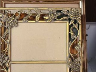 Assorted Picture Frames and a Mirror
