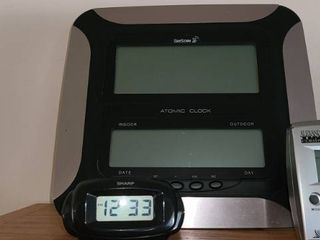 3 Battery Operated Clocks  1 is an Alarm Clock