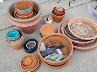 Clay   plastic pots and saucers