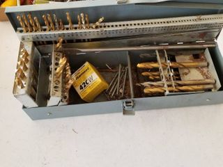 Drill bits with container
