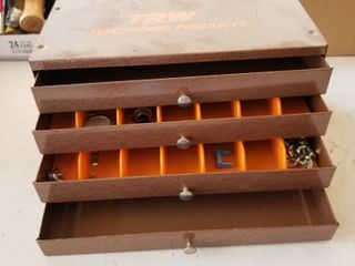Metal storage box with contents