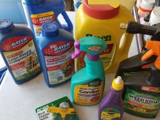 Assorted garden chemicals  more than 1 2 full