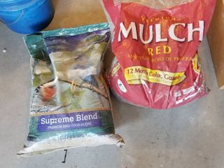 Supreme blend bird seed  unopened  and red mulch