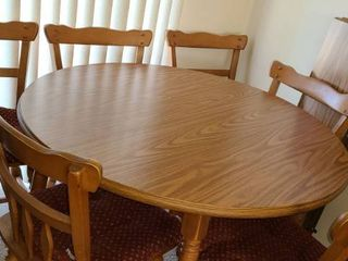 Round Kitchen Table with 6 Chairs  29 x 41 WITHOUT the table leaves  There are 2 leaves that measure 11 5  each