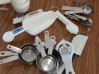Assorted Baking Items  Measuring Cups  Spoons  Spatulas  and few other items