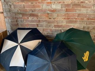 lot of 3 large Umbrellas location Beside Shelf C