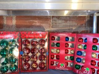 4 Boxes of Christmas Ornaments location Shelf 4