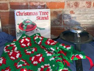 One Crocheted Tree Skirt and Two Christmas Tree Stands location Shelf 4
