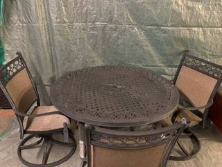 Black Aluminum Patio Table and 3 Swivel Rocking Chairs location 1D Middle