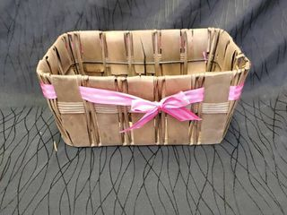 Decorative basket with pink ribbon