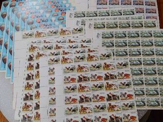 lot of 23 Mint Stamp Sheets of  x10  1983 s Balloons 20c Stamps   x6  1984 s Dogs 20c Stamps   x3  1984 s Hispanic Americans 20c Stamps     x4  louisiana World Exposition 20c Stamps   Scott Numbers   2032 35  2098 2101  2103    2086