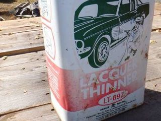 CAN OF lAQUER THINNER WITH CAR