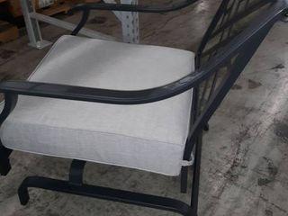 Metal rocking patio chair with grey cushion