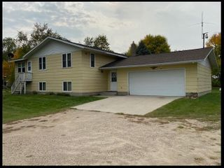 2+ Bedroom Home with Attached Garage and Storage Buildings on 2.5 acres +/- with Tar Road Access.
