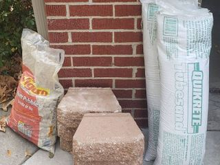 6 landscaping Stones  Bag of River Pebbles  and 2 Bags of Quikrete Tubesand