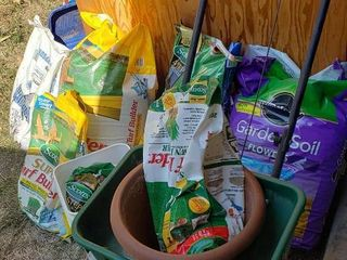 Scotts Broadcast Spreader and Partial Bags of Fertilizer and Garden Soil