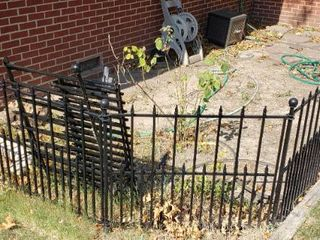 10 Sections of 36 x 30 in  Hollow Metal Black Fencing W  Stakes and One Double Gate Section  42 in wide    winning bidder must disassemble to remove