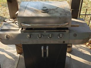 Char Broil Stainless Steel Propane BBQ Grill w Single Eye Burner Attachment  Side Tray Attachment  and Rotating Cook System   55 x 24 x 46 in  tall   includes Floor Mat   No Propane Tank included