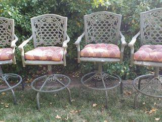 4 Cast Aluminum Bar Height Bar Stools W Seat Cushions   25x 22 x 46 in  tall   Seat  18 in  wide   2 Swivel and 2 stationary due rusting at pivoting area