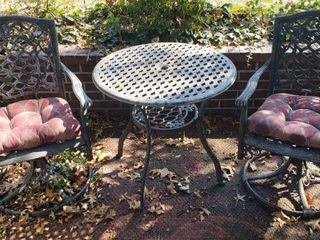 Cast Aluminum Patio Table and Swivel Chair Set   Table  30 in  diameter x 28 in  tall  Chairs  25 x 26 x 36 in  tall w Seat  18 in wide w cushions   Set coating is oxidizing   chipping