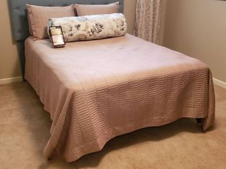 Full Size Quilted Bedspread  4 Pillows  2 shams  1 Floral Body Rol Pillow  Wonder Skirt  and Other linens  sheets   Blanket    Bed   Headboard NOT included