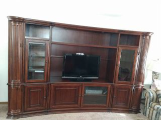 Entertainment Center With Hideaway Shelves and Variable Touch Activated lighting