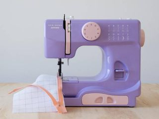 Janome New Home Portable Sewing Machine  lady lilac