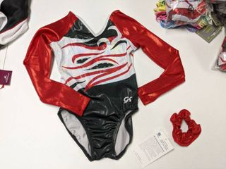 8  Competition leotards And Assorted Hairbands