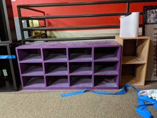 Purple Cubbies With Brown Shelf