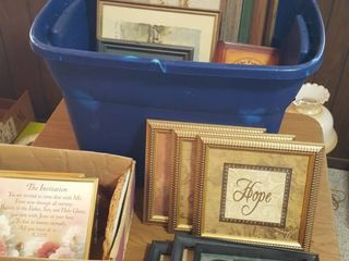 tub of assorted picture frames