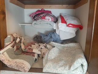 Bed Spreads and Blankets in Closet