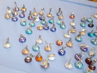 Approximately 100 small figurines on glass beads