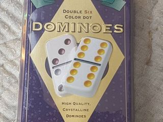 Double six dominoes in tin  sealed   unopened