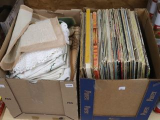 2 BOXES OF RECORDS AND DOIlIES
